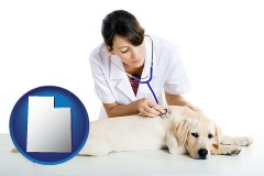 utah map icon and a female veterinarian caring for a Labrador retriever